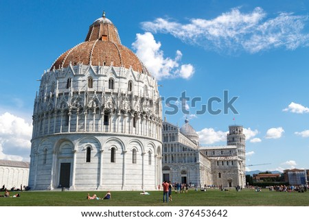 PISA, ITALY - SEPTEMBER 21, 2015 : View of Baptisery building in Cathedral Square in Pisa, Italy, on cloudy blue sky background. - stock photo