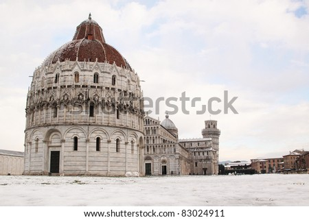 Pisa, Italy, view of the cathedral and leaning tower under the snow - stock photo