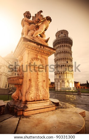 "Pisa leaning Tower and the ""Fontana dei putti"" - stock photo"