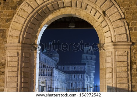 Pisa with the leaning tower in the night - stock photo