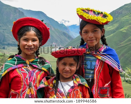 PISAC, PERU - MARCH 2, 2006: Unidentified children at Mirador Taray near Pisac in Peru. Mirador Taray is a scenic vista along the highway overlooking Sacred Valley of the Incas. - stock photo