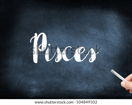 Pisces written on a blackboard