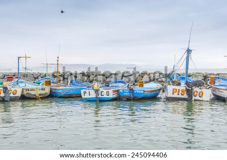 PISCO, PERU, MAY 21, 2014 - The picturesque fishermen's wharf of San Andres. Fishing boats moor in port