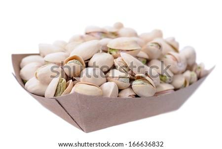 pistachio in bucket isolated on white - stock photo
