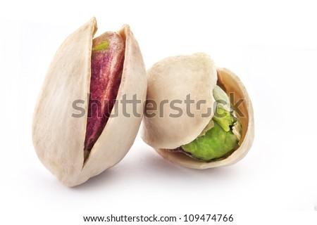 Pistachio nuts, fruits isolated on white background - stock photo
