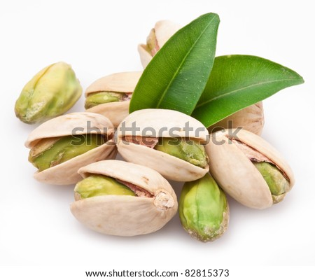 Pistachio nuts. Isolated on a white background. - stock photo