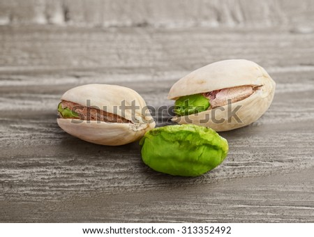 Pistachio nuts  on a vintage wooden background - stock photo