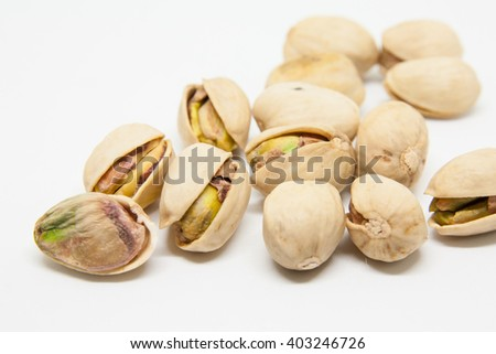 Pistachio on white background - stock photo
