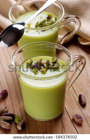 pistachio pudding into glass cup - stock photo