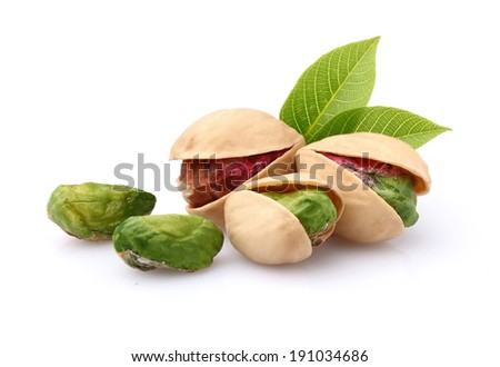 Pistachio with leaves - stock photo