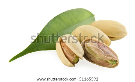 Pistachios and a green leaf on a white background