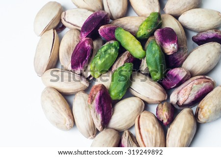 Pistachios and heart shape on wooden table.closeup - stock photo