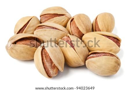 pistachios heap against white background - stock photo