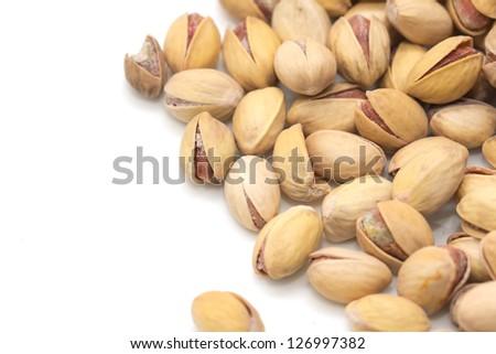 pistachios on a white background. macro - stock photo