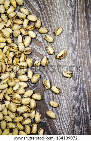 Pistachios on a wood background - stock photo