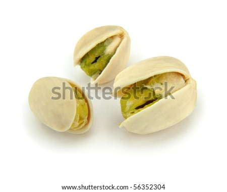 Pistachios with shell on white - stock photo