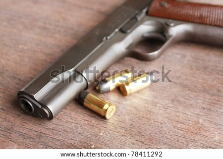 Pistol and bullets - stock photo