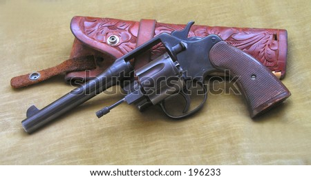 pistol and holster - stock photo