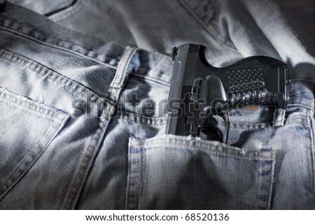Pistol and jeans pocket