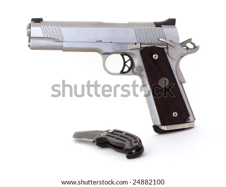 Pistol and knife - stock photo