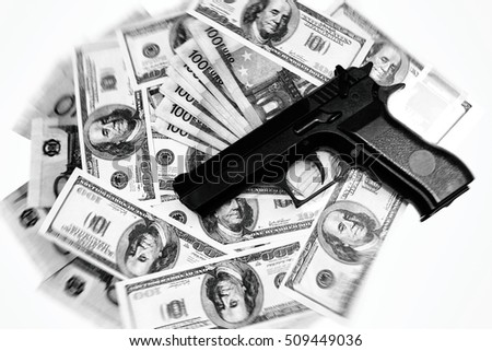 Pistol and money. Dollars, Euros and weapons. The concept of dirty money and blood money