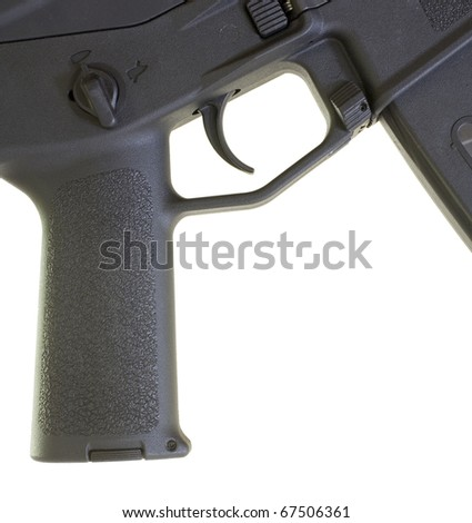 Pistol grip and the trigger group on an assault weapon - stock photo
