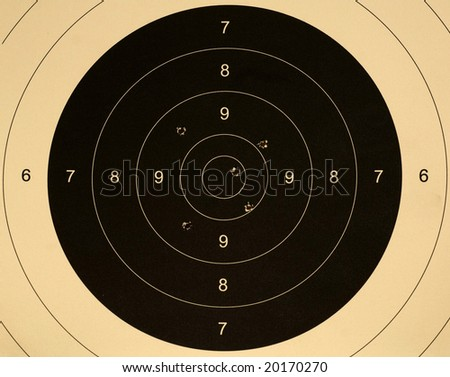 Pistol 25 meter target with 5 holes, 47 scored - stock photo
