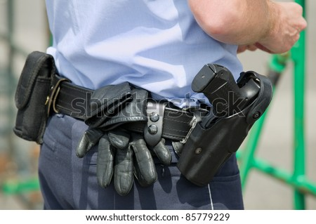Pistol of a police officer - stock photo