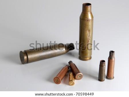pistol rifle and machine gun cartridge case - stock photo