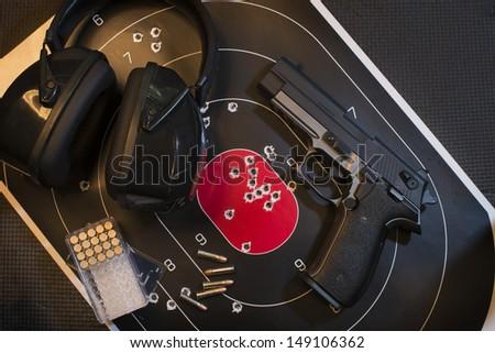 Pistol, Target and Ammo - stock photo