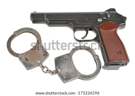 Pistol with handcuffs isolated on white background - stock photo