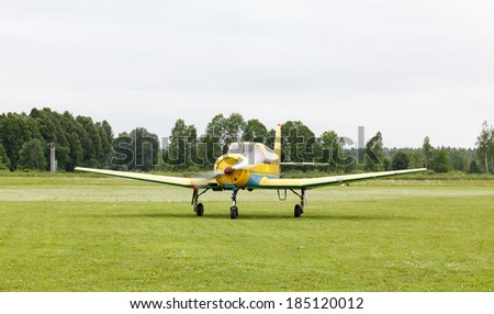 piston training aircraft on the ground with the engine running - stock photo
