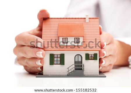 pisture of man and woman hands holding paper house - stock photo