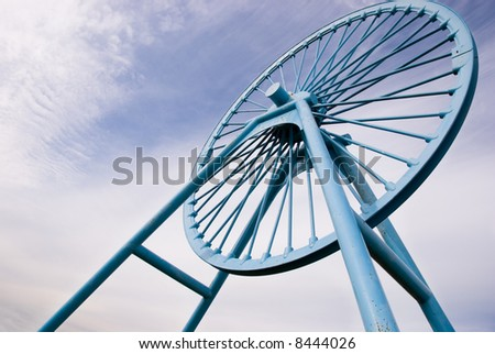 Pit wheel monument at Apedale, Silverdale, Stoke-on-Trent, Staffordshire - stock photo