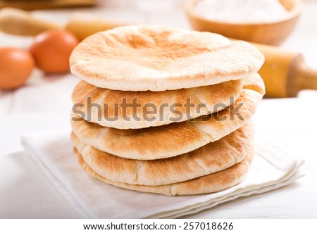 pita bread on wooden board - stock photo