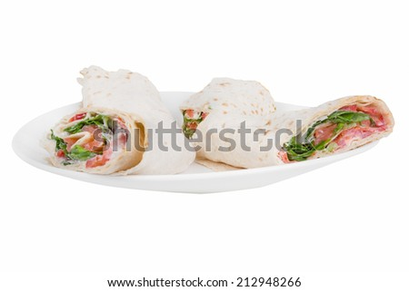 pita bread with salmon on a plate on a white background