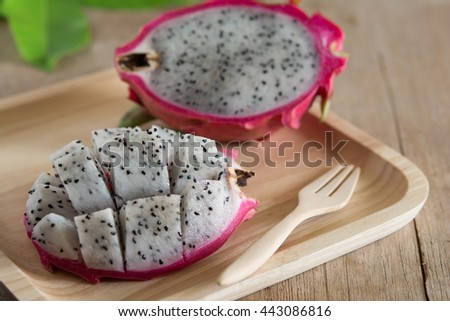 Pitahaya dragon fruit tropical fruit on wooden tray