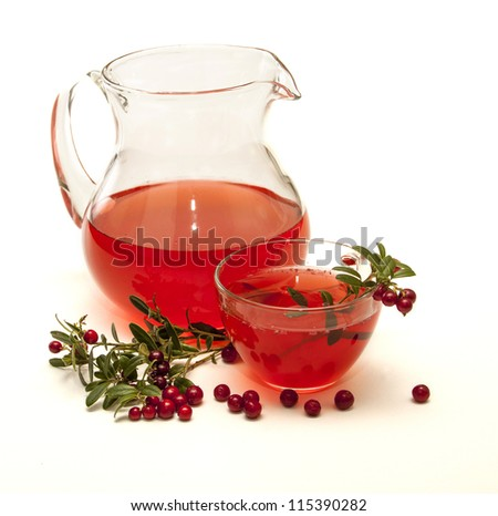 Pitcher and bowl with a drink from the berries cranberries.
