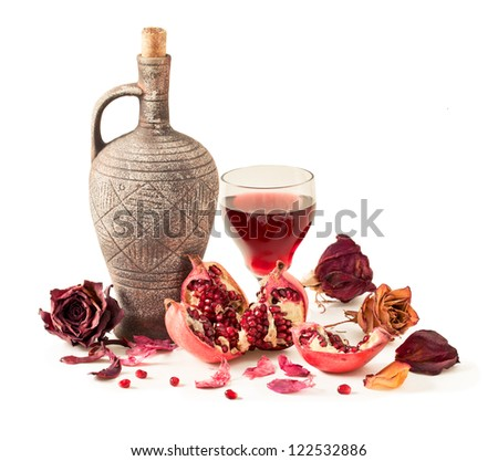 Pitcher and pomegranate juice in a glass of pomegranate on a white background - stock photo