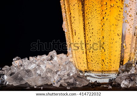 Pitcher of beer with ice - detail - stock photo