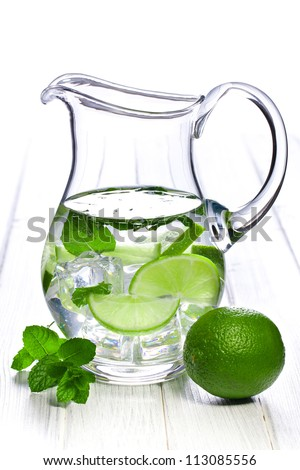 pitcher of lemonade with lime and mint - stock photo