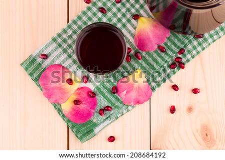 Pitcher of pomegranate juice with pomegranates. Whole background. - stock photo