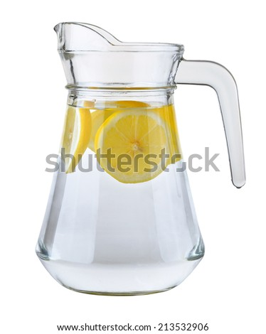 Pitcher of water with lemon slices   - stock photo