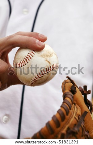 Pitcher showing how to grip the baseball