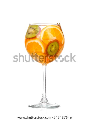 pitcher with a refreshing drink with lemon slices of orange and kiwi on white background - stock photo