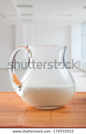 pitcher with milk on table - stock photo