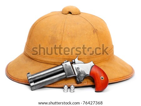 Pith helmet and double-barrelled pistol. Isolated on white background.
