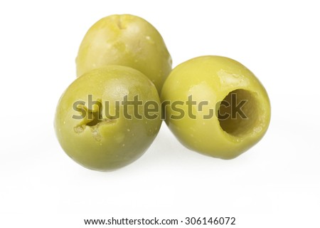 Pitted green olives close up on the white  - stock photo