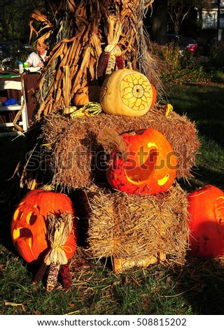 Pittsboro, North Carolina - October 30, 2016:  Elaborately carved jack-on-lanterns at the annual Fearrington Village Pumpkinfest Halloween event