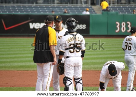 PITTSBURGH - SEPTEMBER 24: Pittsburgh Pirates' pitching coach speaks with Charlie Morton during a game against Cincinnati Reds on September 24, 2009 in Pittsburgh, PA. - stock photo